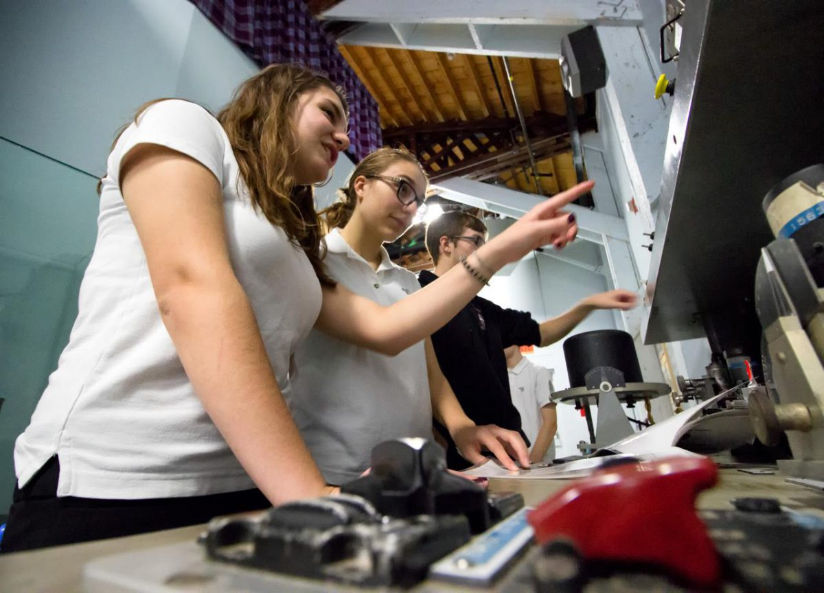 Students play with vintage radar equipment at the Royal Canadian Air Force museum at CFB Borden.